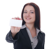 Businesswoman showing and handing a business card. Businesswoman showing and handing a blank business card Stock Photography