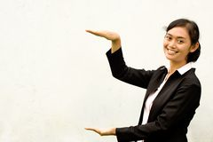 Businesswoman showing height with her hands Stock Image