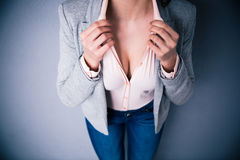 Businesswoman showing her breasts Stock Image