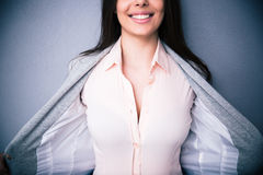 Businesswoman showing her breasts. Closeup image of a Businesswoman showing her breasts Royalty Free Stock Photography