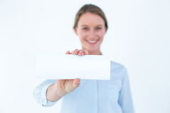 Businesswoman showing her business card Stock Photos