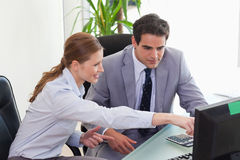 Businesswoman showing her colleague something on the screen Stock Images