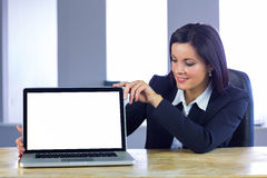 Businesswoman showing her laptop screen Stock Images