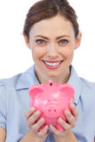 Businesswoman showing her piggy bank to camera Royalty Free Stock Photography