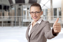 Businesswoman showing his thumb up with smile Stock Photos
