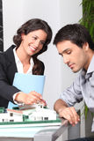 Businesswoman showing  house to client Royalty Free Stock Image