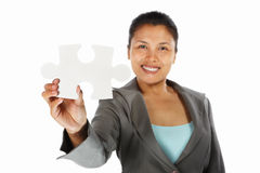 Businesswoman showing jigzaw puzzle piece Stock Photography