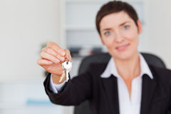 Businesswoman showing keys. With the camera focus on the keys Stock Image