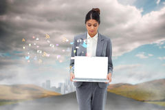 Businesswoman showing laptop with app icons Royalty Free Stock Photos