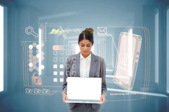 Businesswoman showing laptop with interface Royalty Free Stock Photo