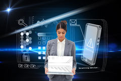 Businesswoman showing laptop with interface Stock Photo