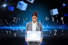 Businesswoman showing laptop with letters Royalty Free Stock Images
