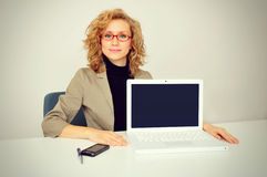 Businesswoman showing a laptop screen. In office royalty free stock images