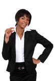 Businesswoman showing a little sign Stock Photos