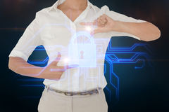 Businesswoman showing lock on circuit board Stock Images