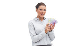 Businesswoman showing lots of money Stock Photos