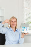 Businesswoman showing model house Stock Photography