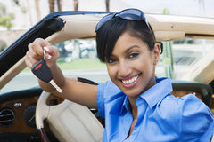 Businesswoman Showing New Car Keys Stock Images