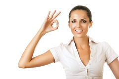 Businesswoman is showing ok gesture Stock Photography
