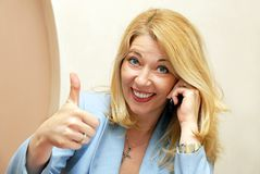 Businesswoman showing ok sign Stock Photo