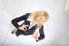 Businesswoman showing OK sign in her office Stock Photos