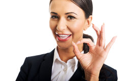 Businesswoman showing ok sign Stock Photos