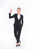 Businesswoman showing OK sign Stock Images