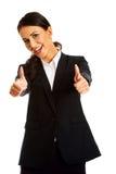 Businesswoman showing ok sign Stock Photos