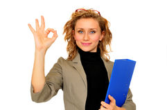 Businesswoman showing Ok Sign. Young businesswoman showing Ok Sign, on a white background royalty free stock photo