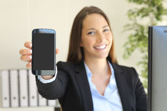 Businesswoman showing phone screen Stock Photography
