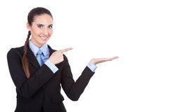 Businesswoman showing product Stock Photos