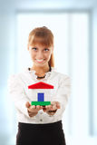 Businesswoman is showing realestate. Businesswoman attractive is showing realestate royalty free stock photos