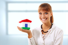 Businesswoman is showing realestate. Businesswoman happy is showing realestate royalty free stock photos