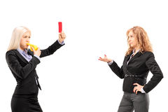 Businesswoman showing a red card to another businesswoman Royalty Free Stock Photos