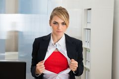 Businesswoman showing red superhero costume Royalty Free Stock Photos