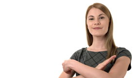 Businesswoman showing on a screen with hand. Standing with arms crossed. Isolated white background stock video footage