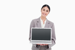 Businesswoman showing screen of her notebook Royalty Free Stock Images