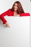 Businesswoman showing signboard, studio on white background. Stock Images
