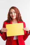Businesswoman showing signboard, studio on white background. Royalty Free Stock Photography
