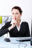Businesswoman showing silence sign Stock Photos