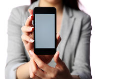 Businesswoman showing smartphone screen Royalty Free Stock Photography