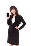 Businesswoman showing smartphone Stock Photo