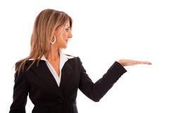 Businesswoman showing something Stock Photos