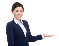 Businesswoman showing something on hand royalty free stock photos