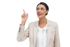 Businesswoman showing something with her finger Stock Photos