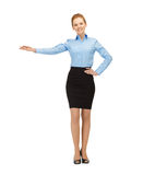 Businesswoman showing something with her hand Royalty Free Stock Photography