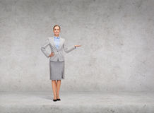 Businesswoman showing something on her hand Royalty Free Stock Photos