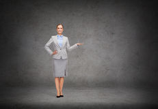 Businesswoman showing something on her hand Stock Image