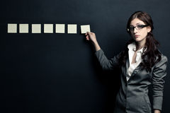 Businesswoman showing sticknotes Stock Photo
