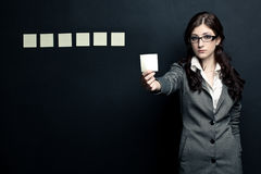 Businesswoman showing sticknotes Royalty Free Stock Photo